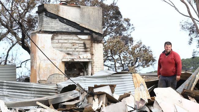 Jared McArdle of the Taljar Polwarth stud at Parndana lost two family homes in the fire and about 15 per cent of their sheep flock. Picture: Tait Schmaal