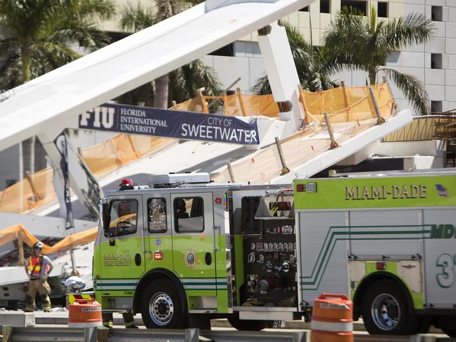 Emergency personnel respond to a collapsed pedestrian bridge at Florida International University. Picture: Daniel A. Varela/The Miami Herald via AP