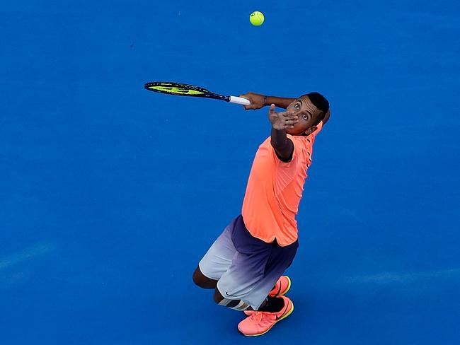 Nick Kyrgios serves during the Hopman Cup.