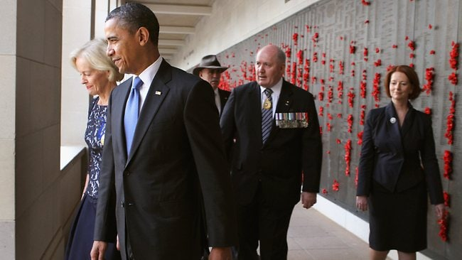 Governor General Quentin Bryce takes Barack Obama through the War Memorial. The PM is not far behind. Picture: Getty Images