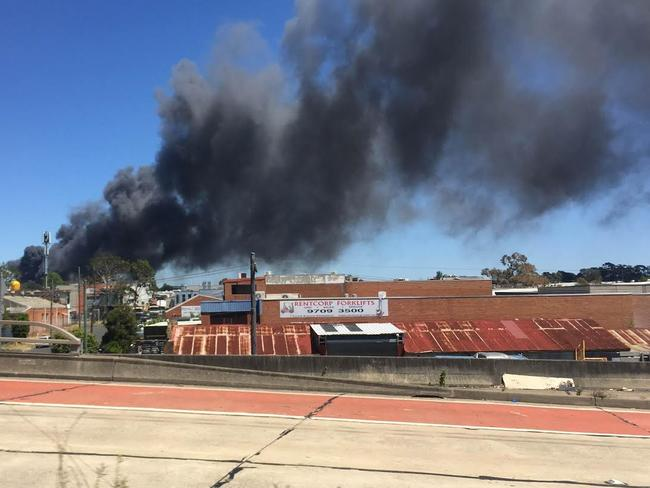 Smoke is billowing over the inner west from a fire in Revesby. Picture: David Meddows