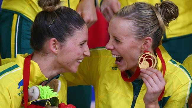 Julie Corletto and Renae Hallinan of Australia celebrate their netball gold medal.