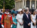 Guests observe a minute's silence in honour of the victims of the attack at Manchester Arena at the start of a garden party at Buckingham Palace on May 23, 2017 in London, England. Picture: Getty
