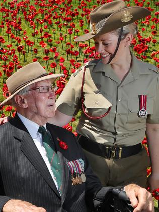 """Alan """"Kanga"""" Moore with army musician Liz Cherry at the Remembrance Day ceremony. Picture: David Crosling"""