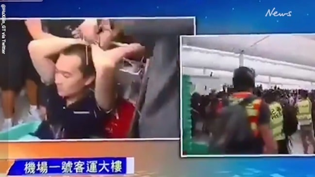 Reporter seized by demonstrators at Hong Kong airport