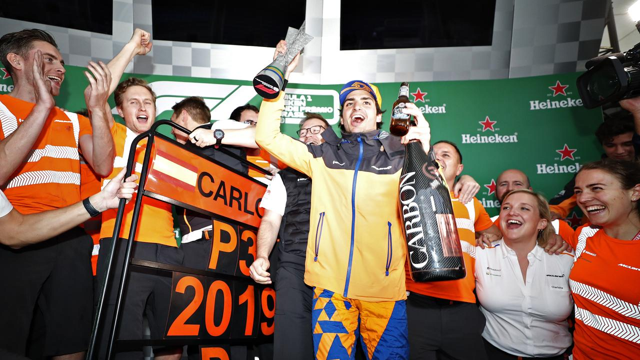Carlos Sainz and McLaren celebrate after later being awarded third place in Brazil.