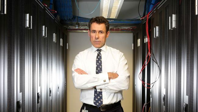 SNP Security's Tom Roche in the company's monitoring room at West Ryde. Picture: Adam Ward