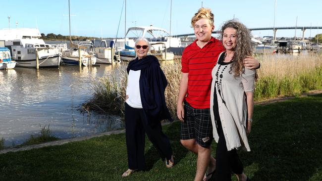 Liane Goldsmith (right) with her son James Goldsmith and mum Val Skinner at the Goolwa river near her Goolwa home. Photo Calum Robertson