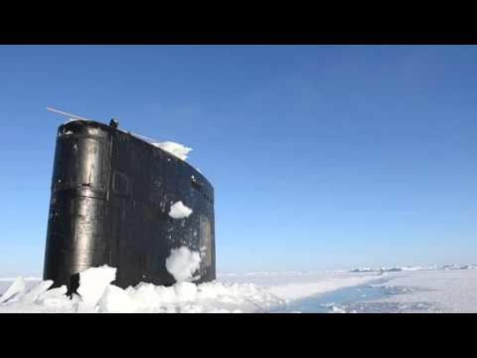 US Submarine Surfaces Through Ice in the Arctic Circle