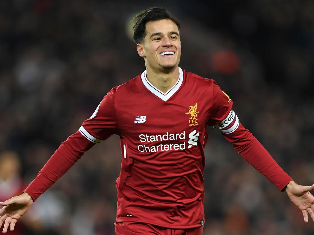 (FILES) This file photo taken on December 26, 2017 shows Liverpool's Brazilian midfielder Philippe Coutinho celebrating scoring the opening goal of the English Premier League football match between Liverpool and Swansea City at Anfield in Liverpool, north west England on December 26, 2017. When Philippe Coutinho joined Liverpool in 2013, the Brazil forward was so lightly regarded that his signing was overshadowed by the arrival of Daniel Sturridge at Anfield earlier that month. But five years later, Coutinho has become such an formidable force that his departure will be mourned by Liverpool fans around the world if Barcelona complete their bid to land the Reds star in a blockbuster transfer.  / AFP PHOTO / Paul ELLIS / RESTRICTED TO EDITORIAL USE. No use with unauthorized audio, video, data, fixture lists, club/league logos or 'live' services. Online in-match use limited to 75 images, no video emulation. No use in betting, games or single club/league/player publications.  / TO GO WITH AFP PROFILE STORY BY STEVEN GRIFFITHS