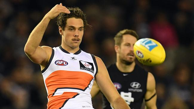 Josh Kelly of the Giants (left) is seen in action during the Round 12 AFL match between the Carlton Blues and the GWS Giants at Etihad Stadium in Melbourne, Sunday, June 11, 2017. (AAP Image/Julian Smith)
