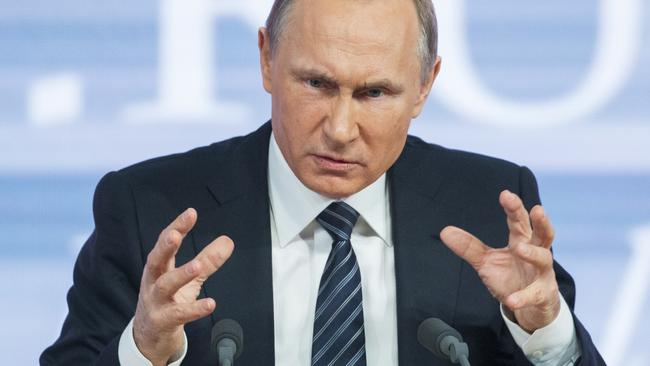 Madness ... A law change ratified by Russian President Vladimir Putin will exempt his government from orders issued by the European Court of Human Rights. Picture: AP/Alexander Zemlianichenko