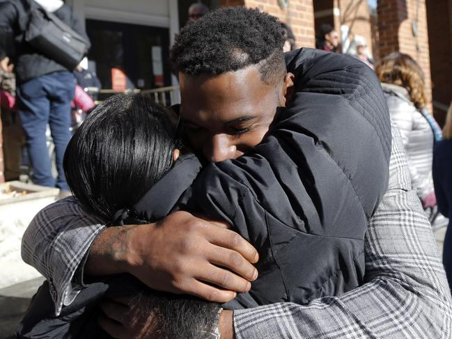 Marcus Martin, who was injured during the 2017 car attack, hugs a supporter after a jury recommended life plus 419 years for James Fields Jr. Picture: AP