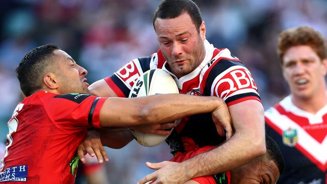 Boyd Cordner braces for contact as he runs the ball against the Dragons.
