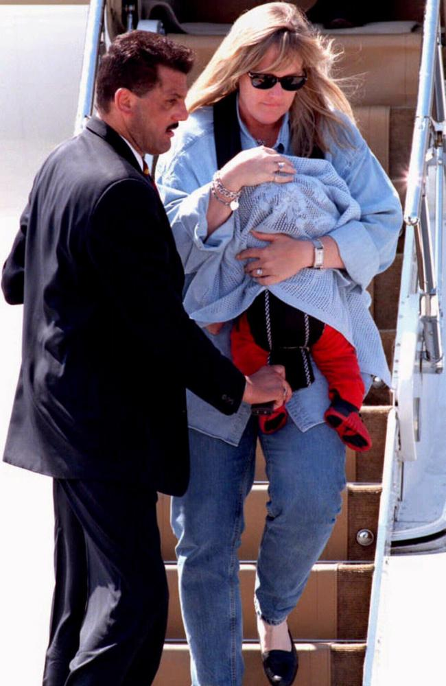 Rowe carries baby Prince in Vienna in July of 1997.
