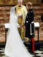 Britain's Prince Harry and Meghan Markle exchange vows during their wedding ceremony at St. George's Chapel in Windsor Castle in Windsor, near London, England, Saturday, May 19, 2018. Credit: Owen Humphreys/pool photo via AP