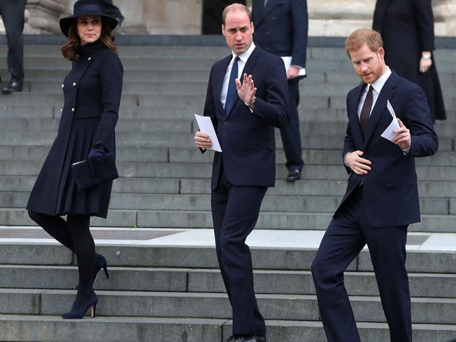 Kate, William and Harry leave the ceremony.