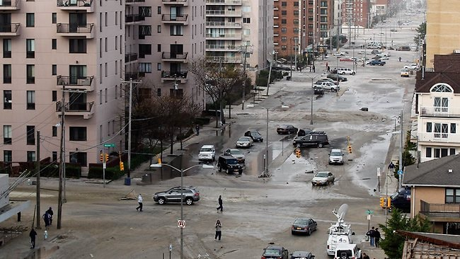 West Broadway is seen covered in beach sand due to flooding from Hurricane Sandy in Long Beach, New York. Pictur: Mike Stobe