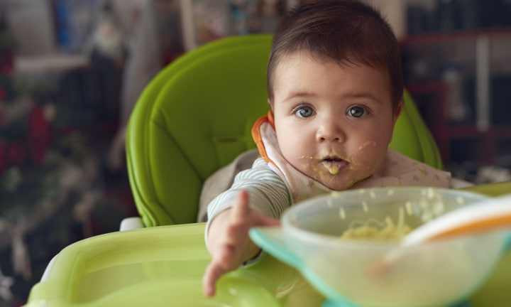 Why starting solids early to help babies sleep is dangerous