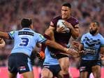 Valentine Holmes (centre) of the Maroons in action against Latrell Mitchell (left) and Josh Addo-Carr (right) of the Blues during Game 3 of the 2018 State of Origin series between the NSW Blues and the Queensland Maroons at Suncorp Stadium in Brisbane, Wednesday, July 11, 2018. (AAP Image/Darren England)