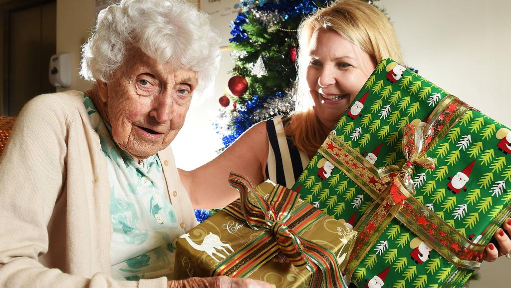 kaye matheson with nursing home resident phyliss merritt as kaye is helping the elderly receive presents