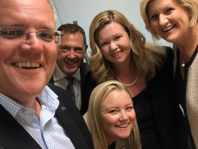 Jessica Whelan (centre) with PM Scott Morrison on Facebook.