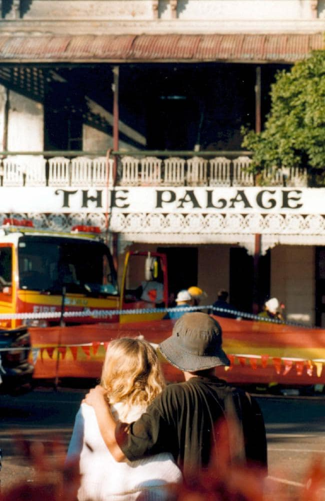 Childers locals out the front of the Palace Backpackers Hostel after 15 people died in the fire. Picture: Paul Burtell.