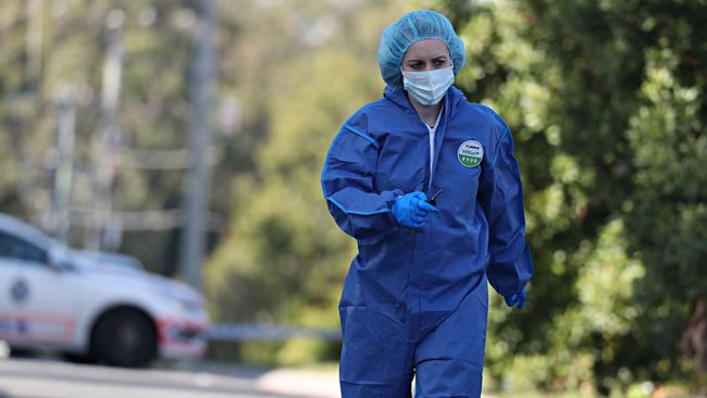 A forensic officer at the scene. Picture: Annette Dew