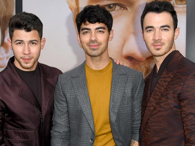 Nick Jonas, Joe Jonas, and Kevin Jonas attend the Premiere of Chasing Happiness. Picture: Getty