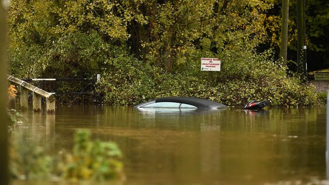 The roof of a car peeks out of the waters of the River Don which burst its banks in Doncaster, northern England. Picture: AFP