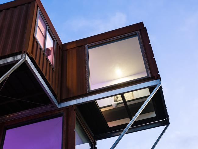 The villa's former use as a shipping container is more apparent from the outside. Picture: Stayz