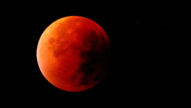 Sometimes called a blood moon, it is a rare astronomical event when a swollen super moon and lunar eclipse combine. Picture: Rémy Mantione