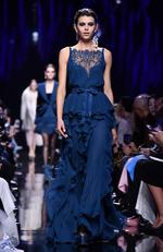 Georgia Fowler walks the runway during the Elie Saab show as part of the Paris Fashion Week Womenswear Fall/Winter 2017/2018 on March 4, 2017 in Paris, France. Picture: Getty