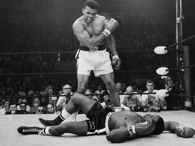Heavyweight champion Muhammad Ali stands over fallen challenger Sonny Liston in 1965.