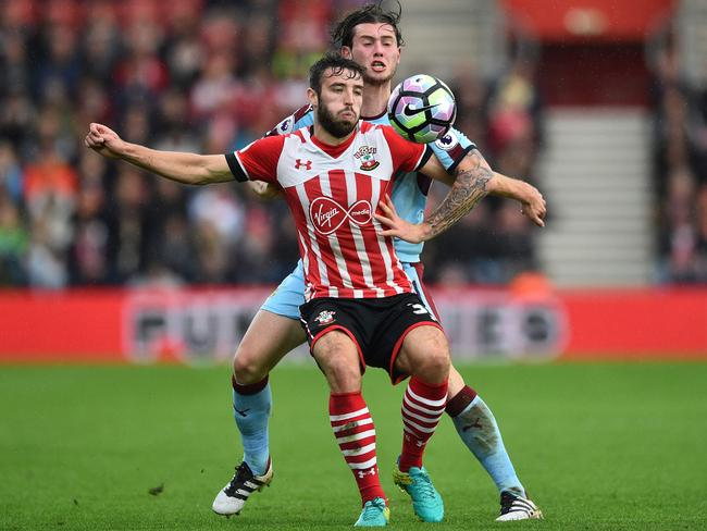 Southampton midfielder Sam McQueen (L) vies with Burnley's Australian midfielder Aiden O'Neill.