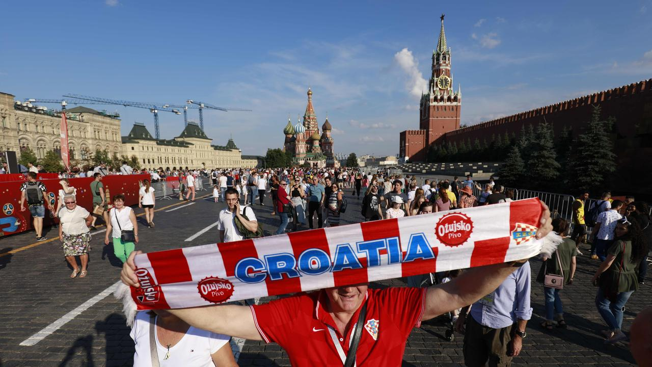 Croatia supporters pose for a picture near the Kremlin
