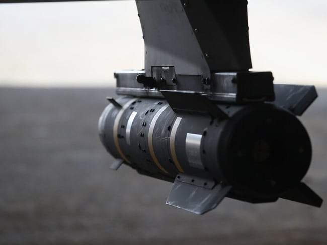 A Hellfire missile hangs from a U.S. Air Force MQ-1B Predator unmanned aerial vehicle (UAV), at a secret air base in the Persian Gulf region. Picture: Getty
