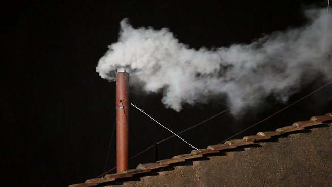 White smoke billows from the chimney on the roof of the Sistine Chapel indicating that the College of Cardinals have elected a new Pope on March 13, 2013 in Vatican City, Vatican. Picture: Peter Macdiarmid/Getty Images