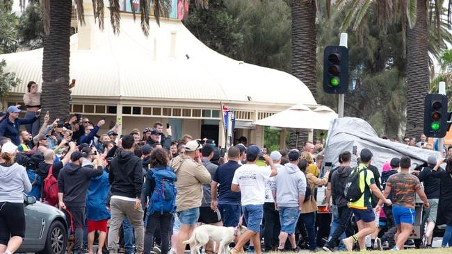 A ute passing by with an anti-racist chant playing is suddenly surrounded by opposing far-right protesters on Beaconsfield Parade. Picture: Sarah Matray