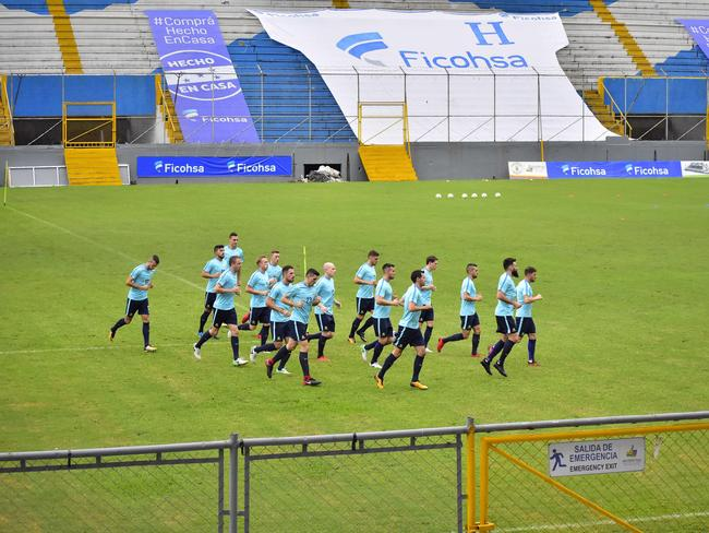Australian soccer players jog during a training session at the Francisco Morazan Stadium