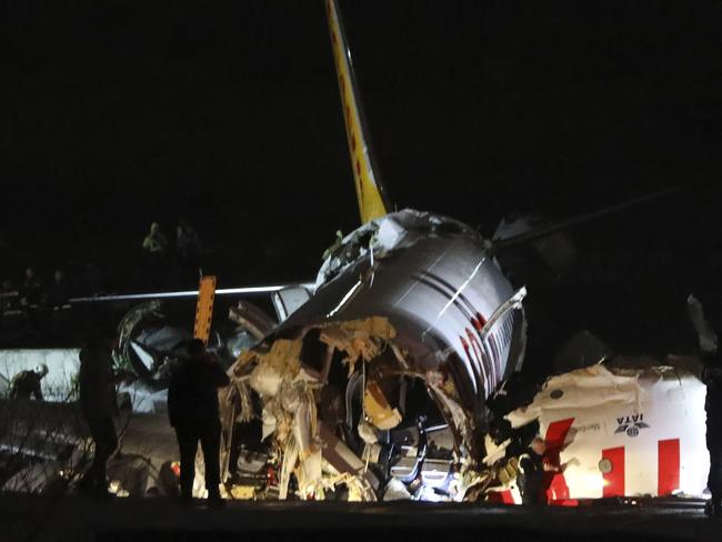Rescue members work after a plane skidded off the runway at Istanbul's Sabiha Gokcen Airport, Wednesday, Feb. 5, 2020. Picture: AP