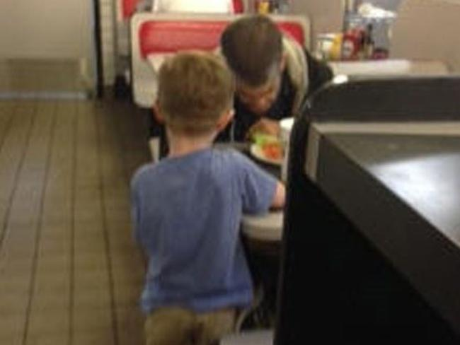 Moment of grace ... Josiah says a blessing with the unnamed man. Picture: WSFA 12