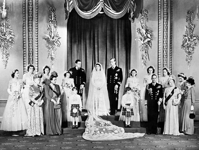 Members of the Royal family including Britain's King George VI (5R) and his wife Queen Elizabeth (3R) posing around the Princess Elizabeth (Queen Elizabeth II) and Philip The Duke of Edinburgh on their wedding day in the Throne Room at Buckingham Palace.