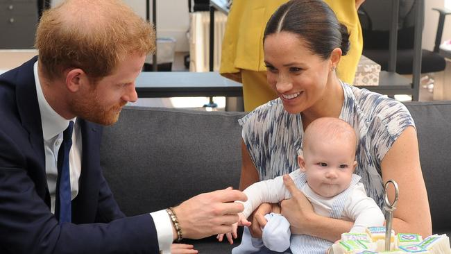 Proud ginger Prince Harry joked about his infant son's choice of friends. Picture: AFP.