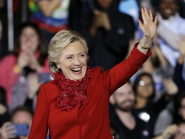 Moving forward: Hillary Clinton waves during a campaign stop in Cincinnati on Monday. Picture: AP Photo/Matt Rourke