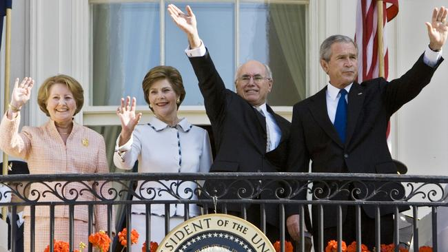 And here they are on the White House balcony. Picture: Paul J. Richards/AFP
