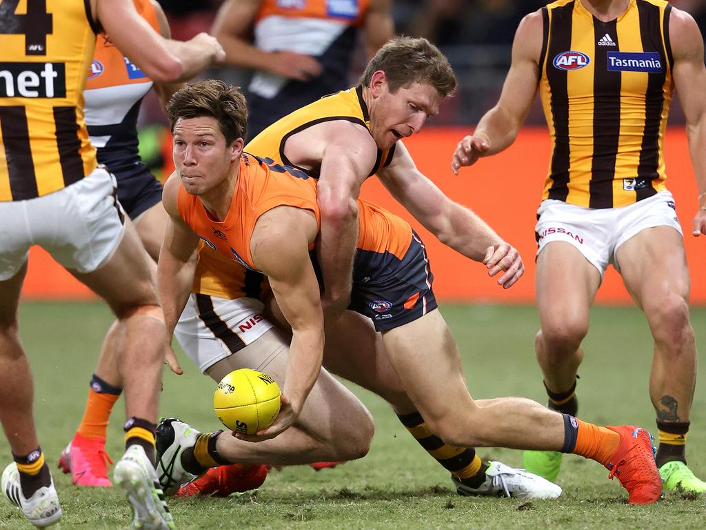Giants Toby Greene and Hawthorn's Ben McEvoy. Picture. Phil Hillyard