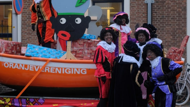 Historically, the first image of Sinterklaas and Zwarte Piet comes from the 1850's storybook. Image: Getty.