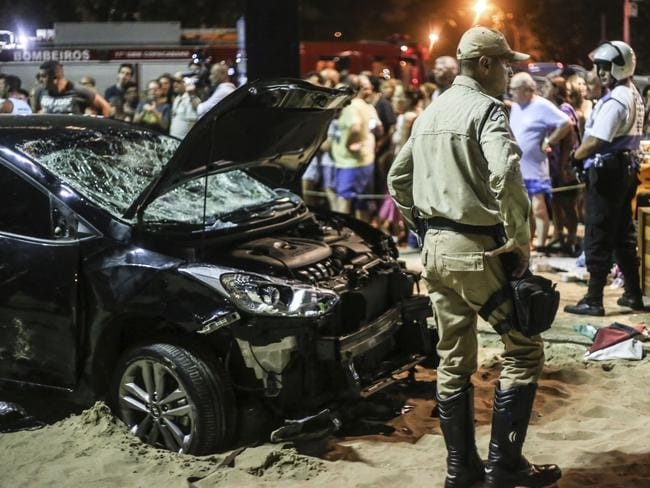 Australian paedophile Christopher Gott was at Copacabana Beach when he was struck by the out-of-control car. Picture: Ian Cheibub