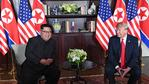 US President Donald Trump (R) and North Korea's leader Kim Jong Un (L) sit down for their historic US-North Korea summit, at the Capella Hotel on Sentosa island in Singapore on June 12, 2018. Picture: AFP PHOTO / SAUL LOEB